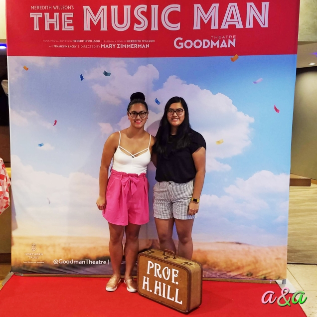 "Amanda and Ashley in front of the Goodman Theatre's ""The Music Man"" photo backdrop"